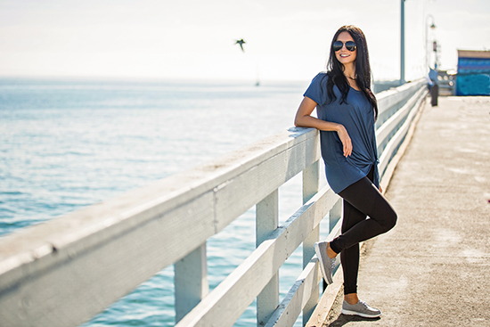 dark haired girl standing on pier overlooking ocean with gray skechers slip on go walk lite isla Your Guide To: Top Womens Canvas Picks For Spring '19