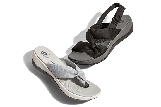 spotlight on comfort group shot of womens clarks cloudsteppers sandals on white background
