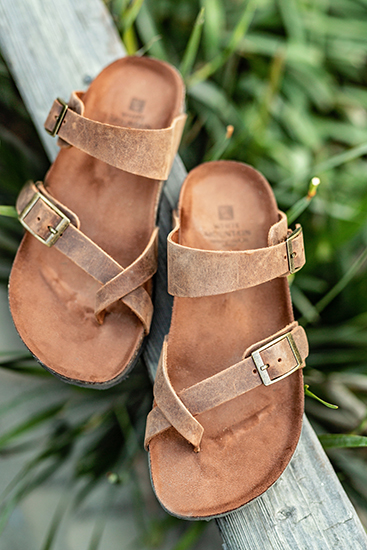 white mountain gracie brown footbed sandal on wood with greenery in background