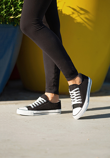 close up image of black canvas slip on ryley girl shoes on sidewalk with colorful background Your Guide To: Top Womens Canvas Picks For Spring '19
